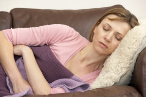 Woman Unwell And Lying On Sofa